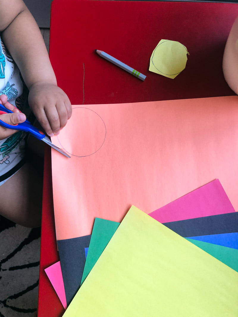 Tracing and cutting circles to make a layers of the earth kids craft