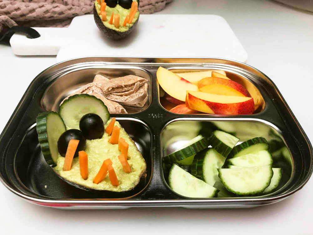 Cute kids lunch in a tray with crocodile shaped veggie dip