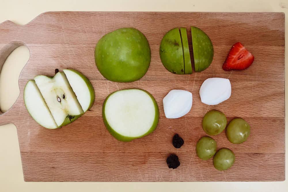Apples cut for frog shaped snack for preschooler