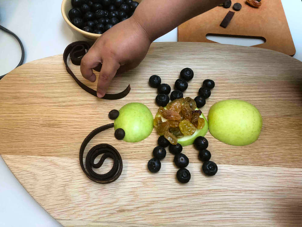 Finished bug themed food - this snack is made by my kid with apples, blueberries, grapes