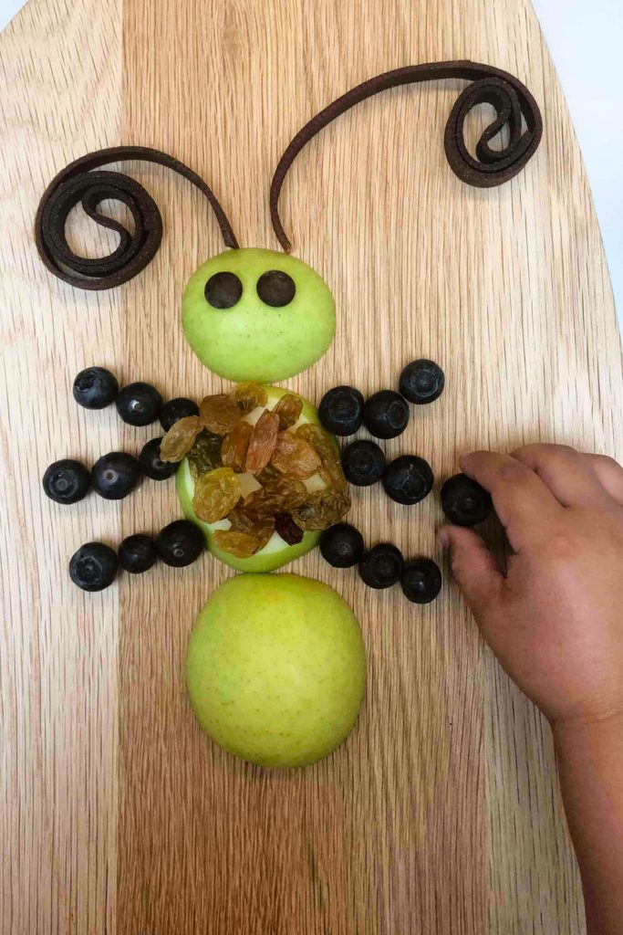 Insect snack ideas - my kid finishing his healthy bug snack