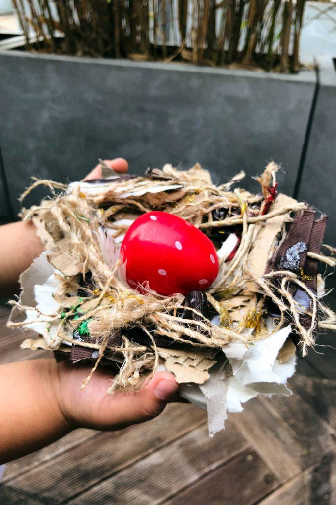 Making a bird nest craft - final nest made by my kid