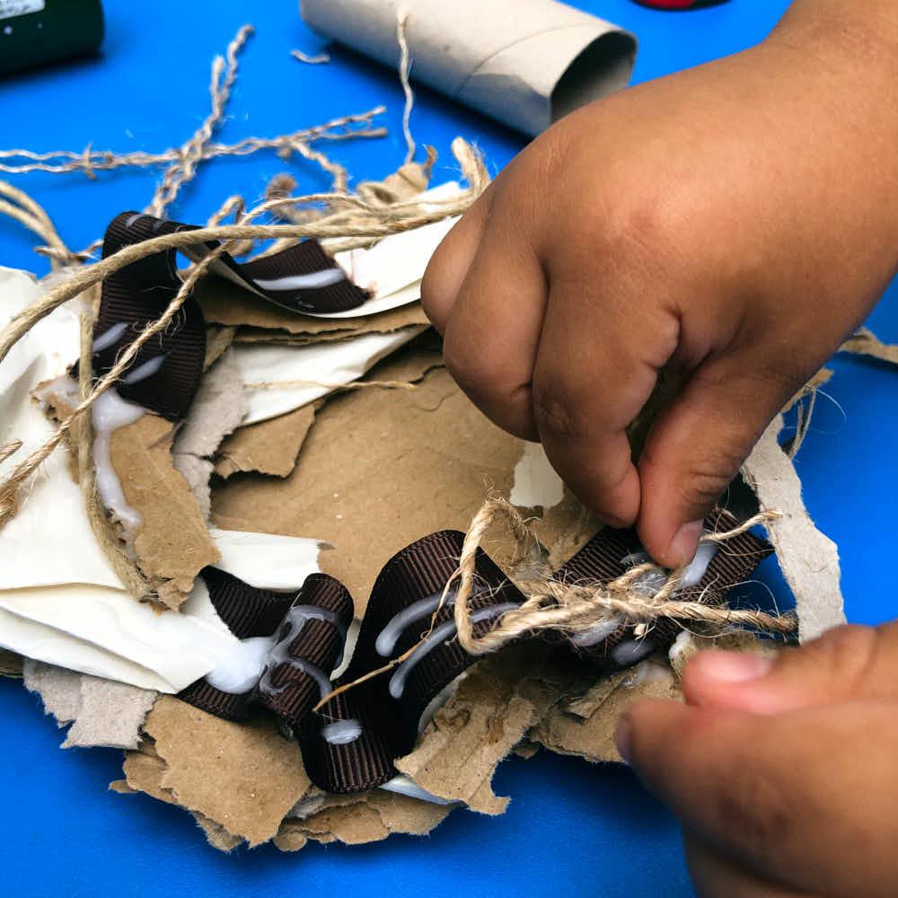 Making a bird nest - my preschool kid making the craft