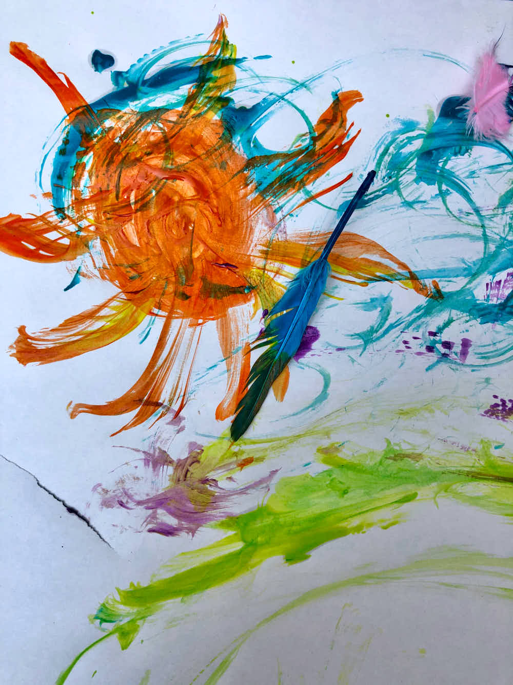 using feathers to paint art with kids - sun